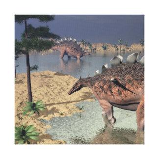 Kentrosaurus dinosaurs in the desert - 3D render Canvas Print