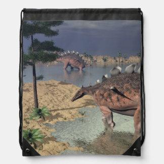 Kentrosaurus dinosaurs in the desert - 3D render Drawstring Bag