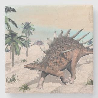 Kentrosaurus dinosaurs in the desert - 3D render Stone Coaster