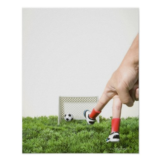 Kicking a soccer ball with finger imitating poster