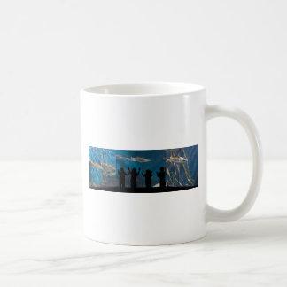 Kids silhouette at aquarium coffee mug