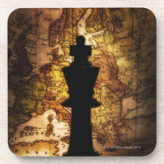King chess piece on old world map beverage coaster