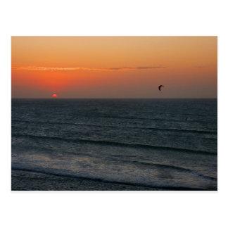 Kitesurfing at sunset postcard