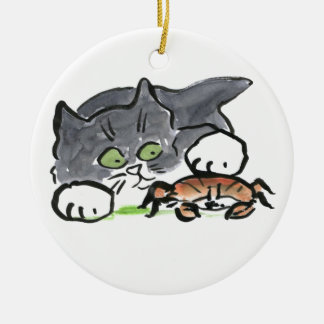 Kitten has found a Crab on the Beach Round Ceramic Ornament