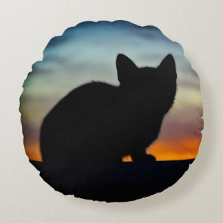 Kitten Silhouette with Sunset Sky Background Round Pillow