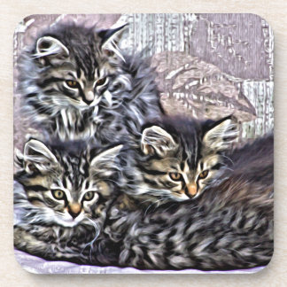Kittens relaxing on a chair drink coaster