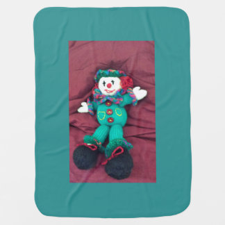 Knitted clown stroller blanket