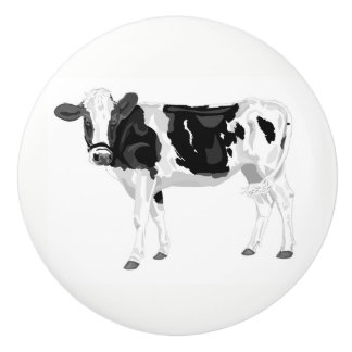 Knob with black and white cow graphic design.