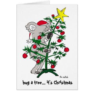 Koala bear hugging a Christmas tree Card