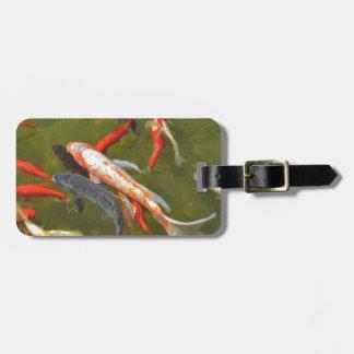 Koi carps in pond luggage tag