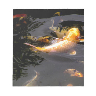 Koi pond in the garden notepad