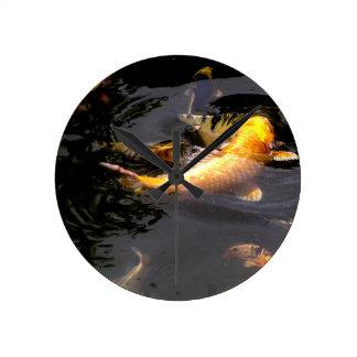 Koi pond in the garden round clock