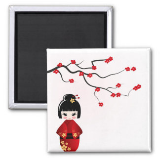 Kokeshi doll under sakura branch magnet