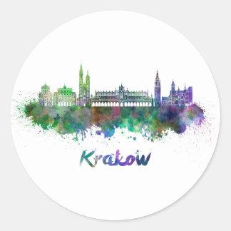 Krakow skyline in watercolor classic round sticker