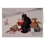 Krampus jouant avec la neige d'enfants cartes de vœux