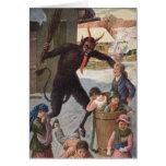 Krampus punissant l'hiver d'enfants de kidnapping carte de vœux