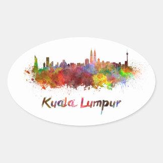 Kuala Lumpur skyline in watercolor splatters Oval Sticker