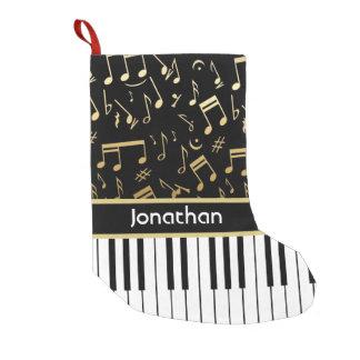 La musique d'or élégante note des clés de piano petite chaussette de noël