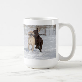 Labrador Retrievers playing in the snow. Coffee Mug