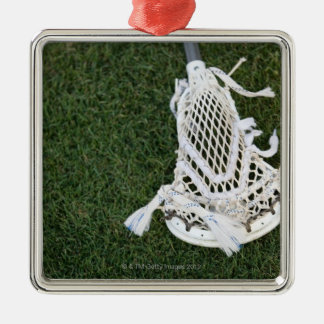 Lacrosse stick on grass metal ornament