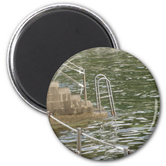 Ladder descending into the sea water 2 inch round magnet