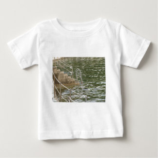 Ladder descending into the sea water baby T-Shirt