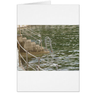 Ladder descending into the sea water card