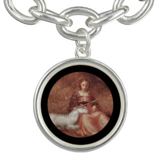 Lady Chastity Holds Unicorn Bracelets