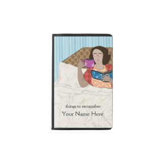 Lady drinking tea in bed pocket moleskine notebook