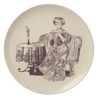 lady drinks tea plate