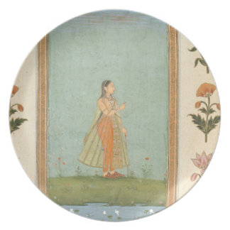 Lady holding a flower, standing by a lily pond, fr plate