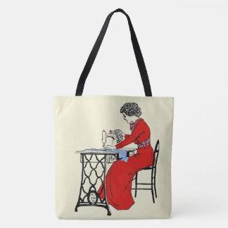 Lady in red dress at vintage sewing machine 2 tote bag