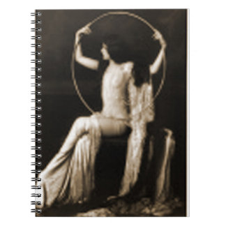 lady with a hoop spiral notebook
