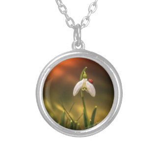 Ladybug and snowdrop silver plated necklace