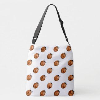 Ladybug in orange crossbody bag