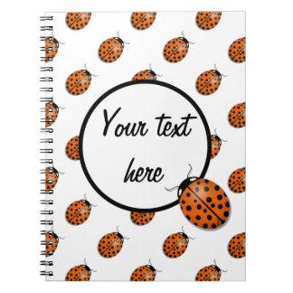 Ladybug in orange notebooks