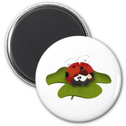 Ladybug on a green leaf magnets