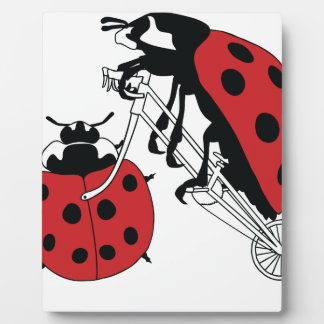 Ladybug Riding Bike With Ladybug Wheel Plaque