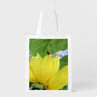 ladybug sitting on a sunflower reusable grocery bag