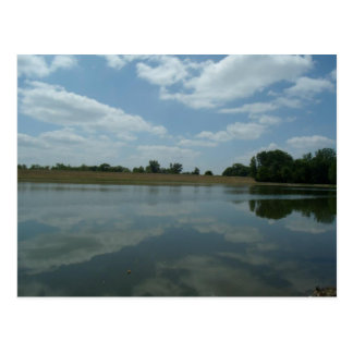 Lake Water Reflects the skies Fluffy White Clouds Postcard