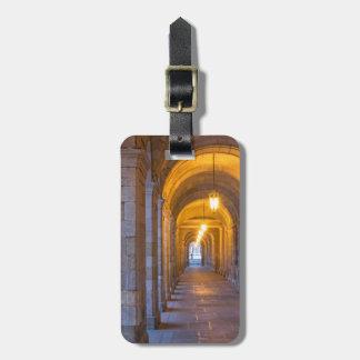 Lamp lit stone hallway, spain luggage tag