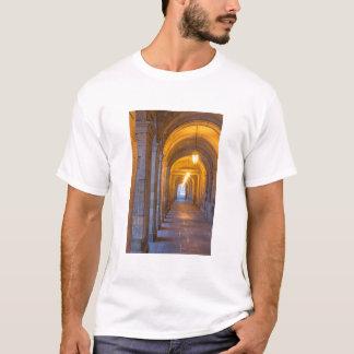 Lamp lit stone hallway, spain T-Shirt