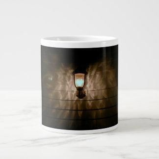 lamp with angel wings reflection on wall jumbo mug