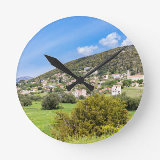 Landscape village with houses in Greek valley Round Clock