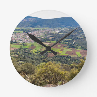 Landscape village with houses in valley of Greece Round Clock