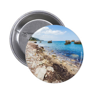 Landscape with boulders and rocks on coast 2 inch round button