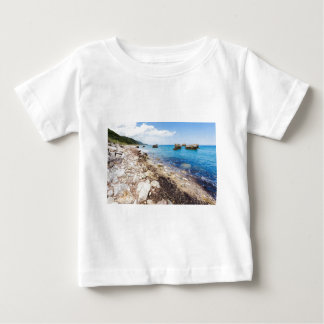 Landscape with boulders and rocks on coast baby T-Shirt