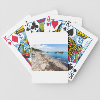 Landscape with boulders and rocks on coast poker deck