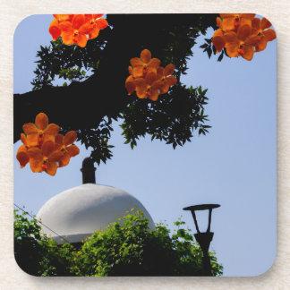 Landscape with orange orchids coaster