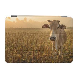 Laos, Vang Vieng. Cow at sunrise iPad Mini Cover
